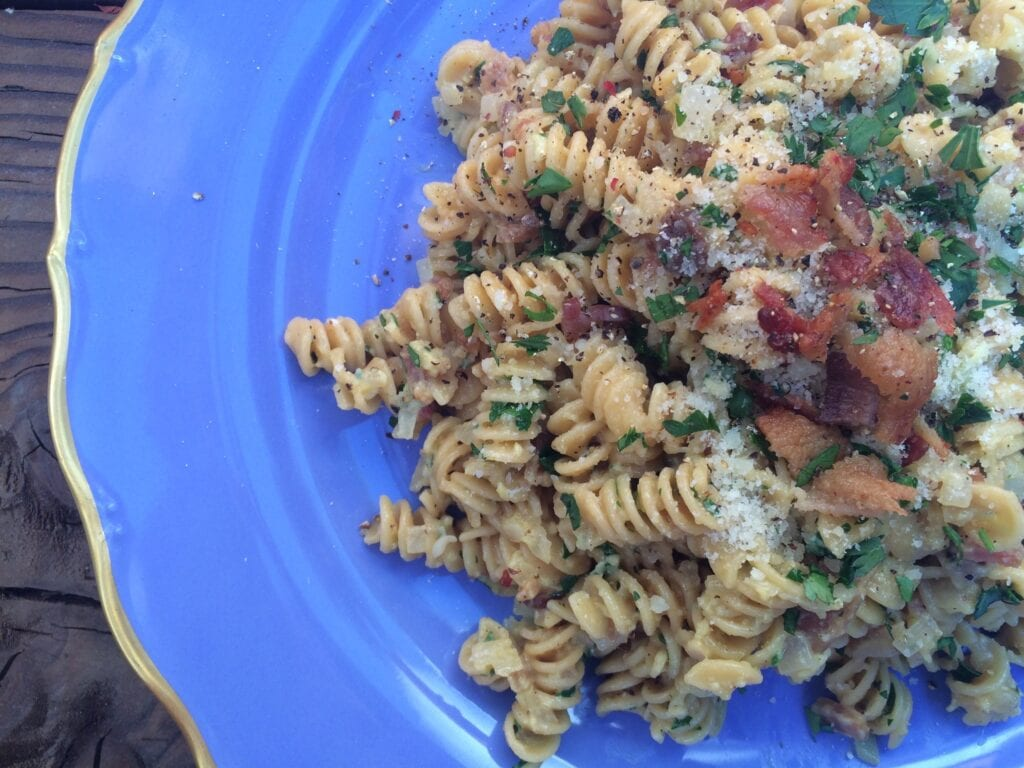 Pasta (rotini) carbonara on a blue plate