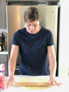 a woman using a rolling pin