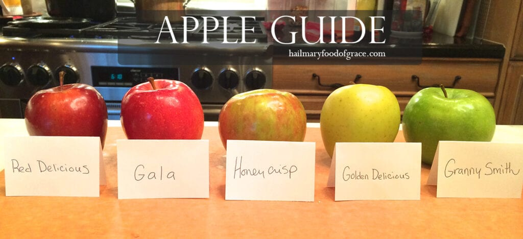 different apples on a table with labels