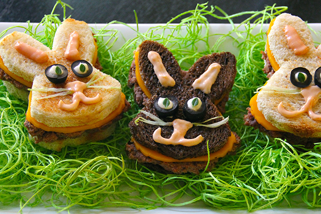 three sandwiches shaped like bunnies with faces