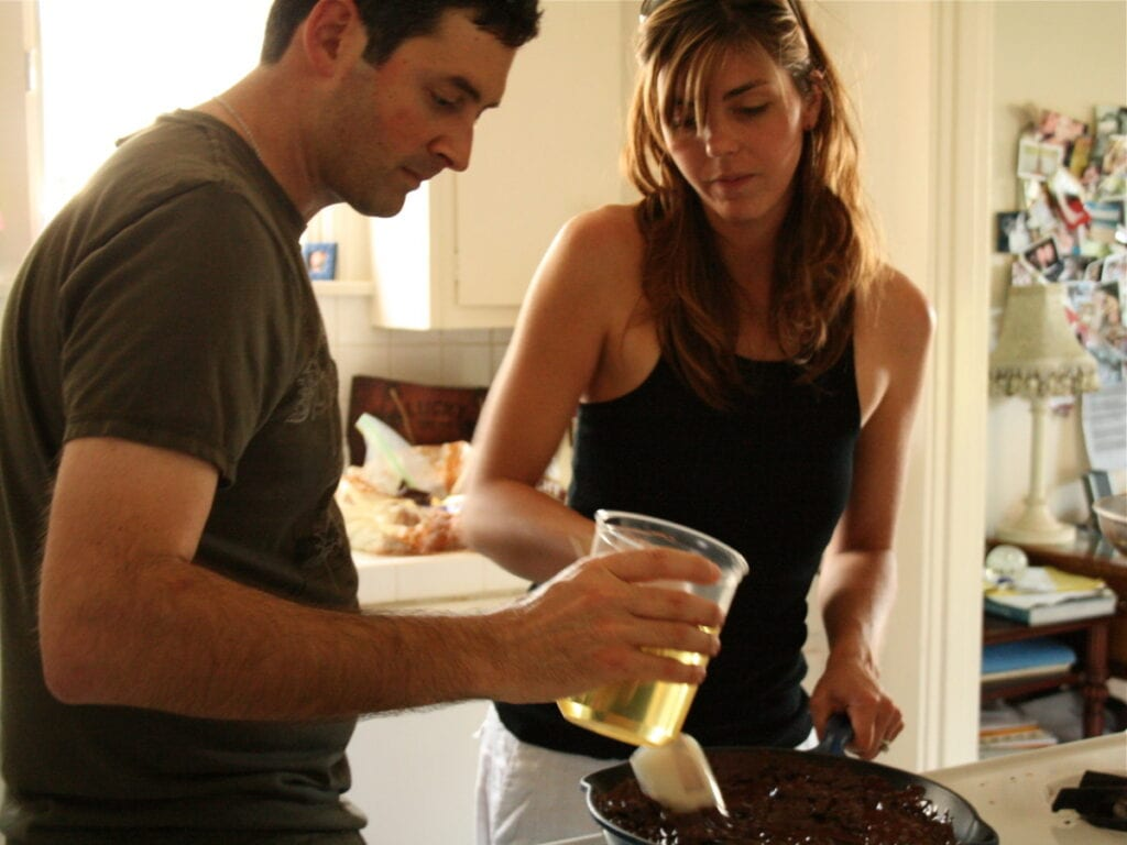 a woman and a man baking together