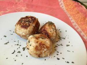 three Turkey meatballs on a plate