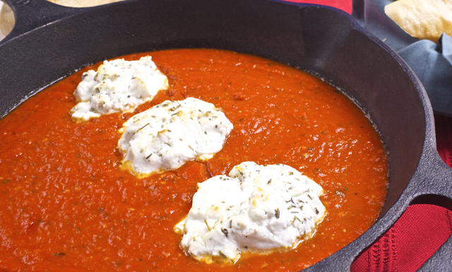 Goat cheese and tomato sauce in a pan