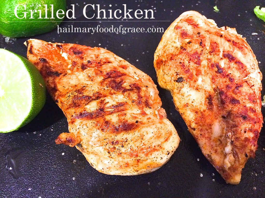two grilled chicken breasts