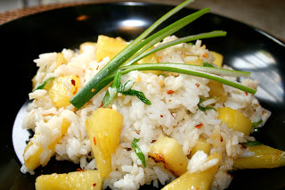 a plate of pineapple fried rice