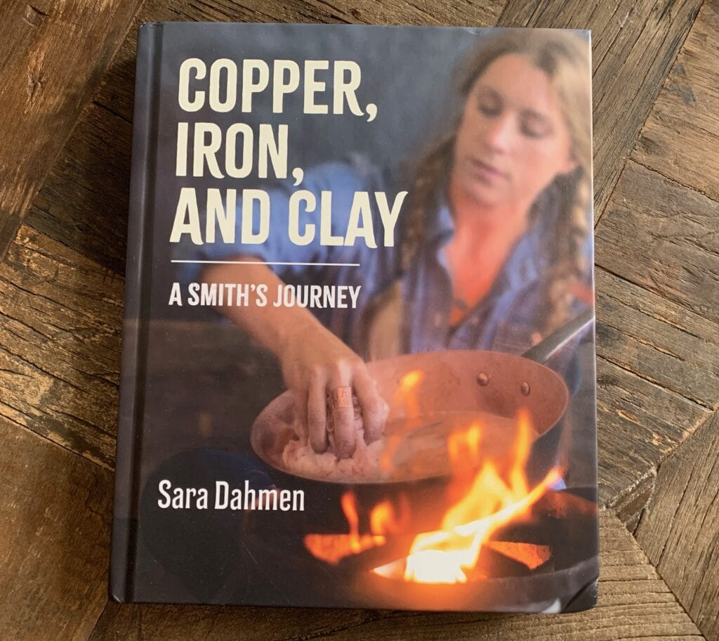 A book titled copper, iron, and clay a smith's journey