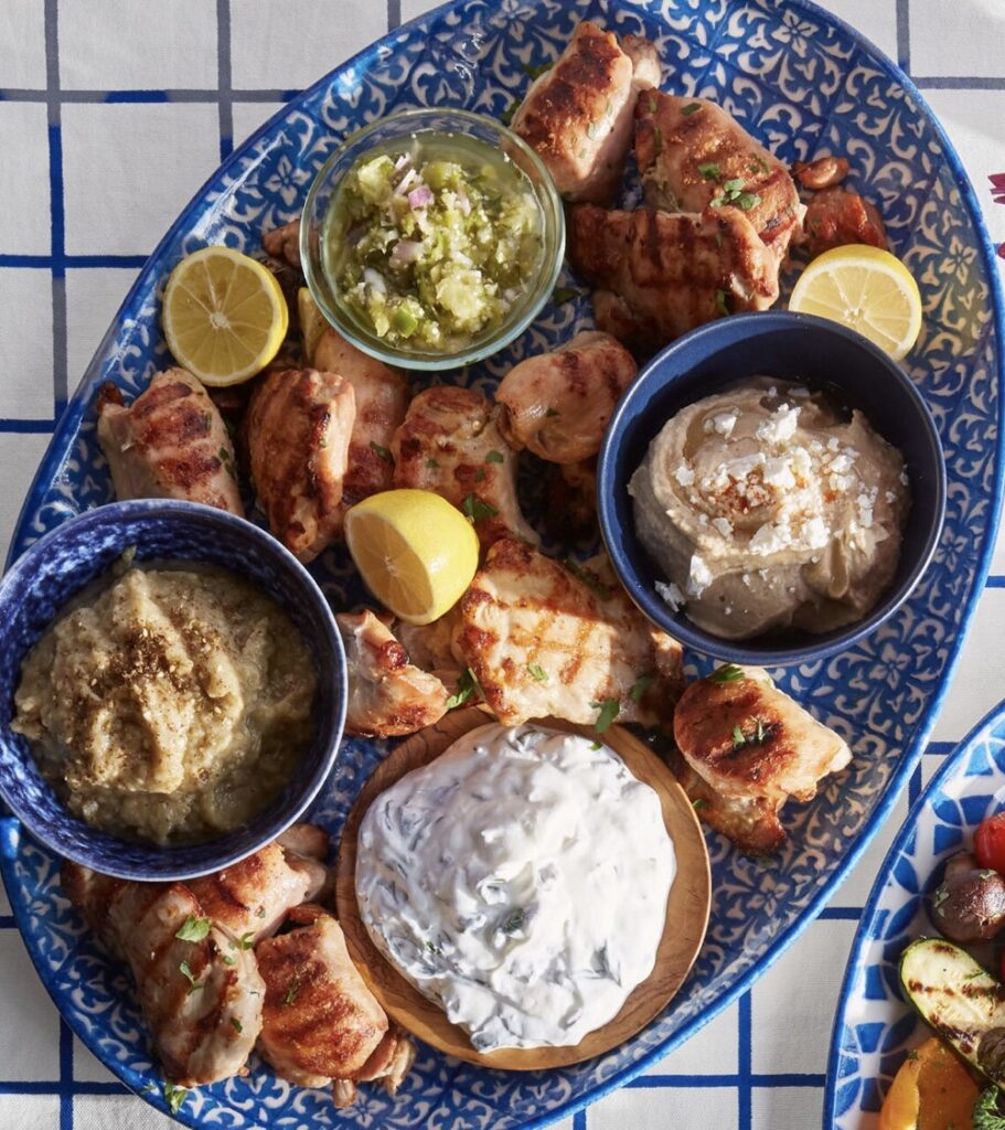 Grilled marinated chicken thighs and Mediterranean toppings